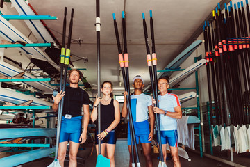 Canoeist team holding paddles