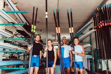 Canoe team posing paddle