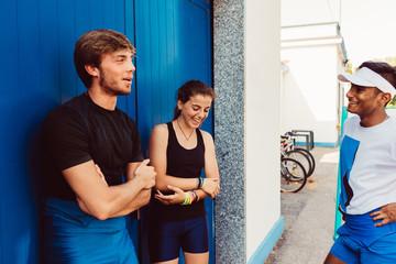 three multiethnic athlete interacting
