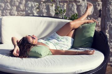woman enjoying sun on terrace
