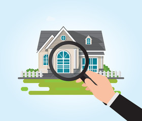 Magnifying glass in human hand with house icon.