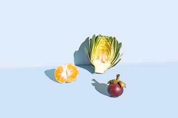 Organic fruit against blue background, studio shot