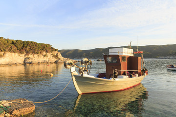 Traditional Greek fishing boats in the natural bay, Colorful boats in Aegean sea, Photo of beautiful blue sea with floating boats and nature