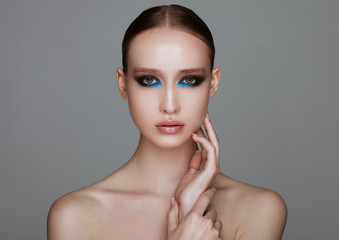 Beauty fashion model with blue lines makeup