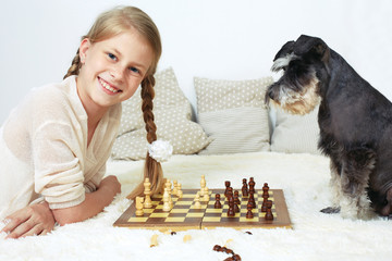 The dog teaches the child to play chess. Your move
