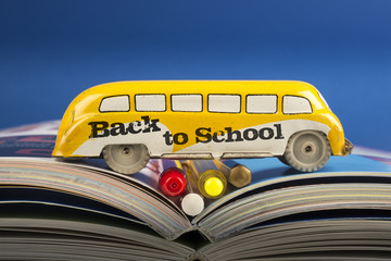Back to school, vintage toy school bus with some pencil and books