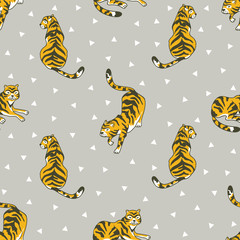 Vector seamless pattern with tigers and triangles isolated on the grey background. Animal  background for fabric or wallpaper boho design.