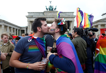 People celebrate Germany's parliament legalising the same-sex marriage in front of the Brandenburg Gate in Berlin