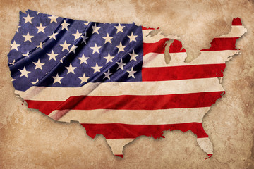 American flag pattern in country map shape on brown texture with clipping path