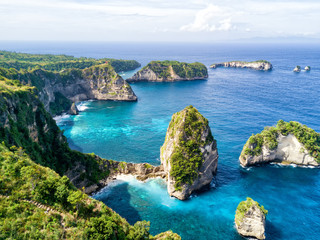Aerial view of the small island of Nusa Batumategan and  Nusa Batupadasan Island from the Atuh Rija Lima shrine on Nusa Penida Island near Bali, Indonesia.