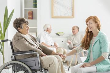 Nurse talking to lady