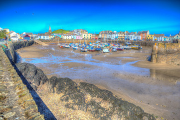 Wall Mural - Ilfracombe Devon harbour with boats in English seaside town in west country colourful bright hdr