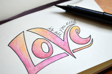 ALL YOU NEED IS LOVE hand lettering in notebook