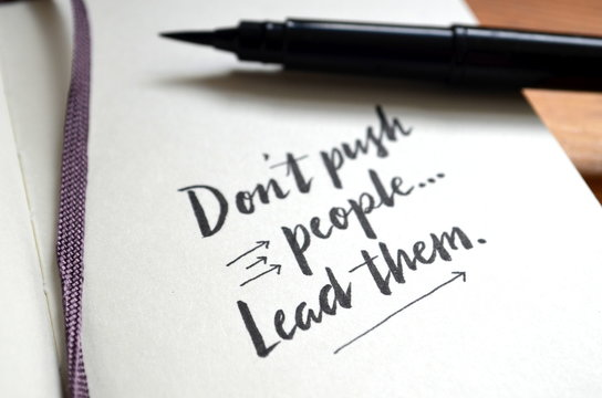 DON'T PUSH PEOPLE. LEAD THEM. hand-lettered in notebook