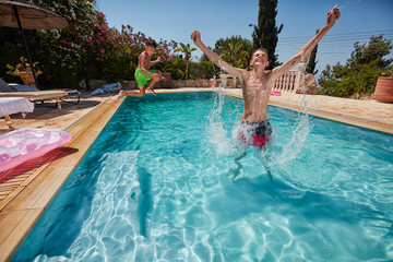 Children frolic in the pool.