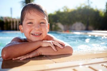 Children frolic in the pool.