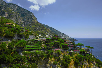 One of the best resorts of Italy with old colorful villas on the steep slope, nice beach, numerous yachts and boats in harbor and medieval towers along the coast, Positano.