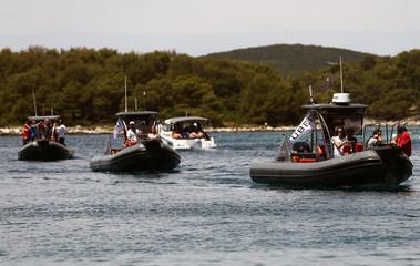Uber boats swim in the Adriatic sea near the island of Solta