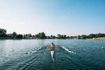 four athlete on canoe rowing