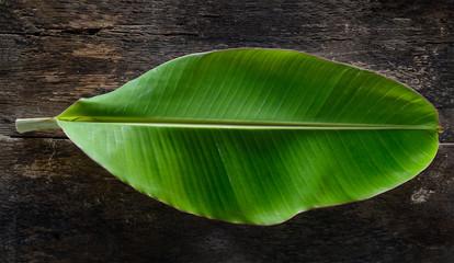 banana leaf on wood