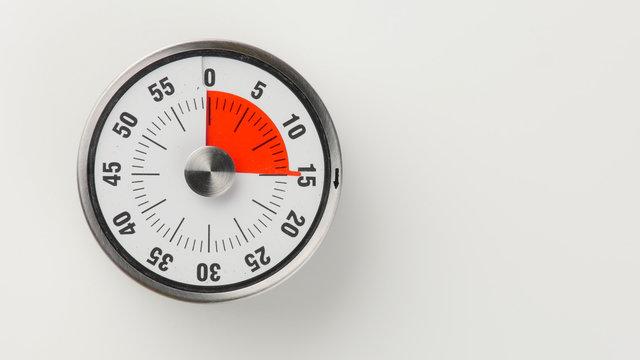 Vintage analog kitchen countdown timer, 15 minutes remaining