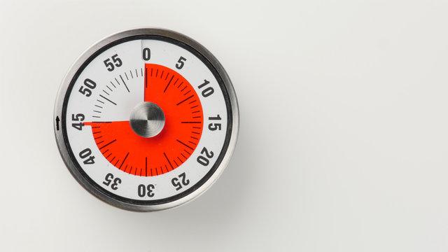 Vintage analog kitchen countdown timer, 45 minutes remaining
