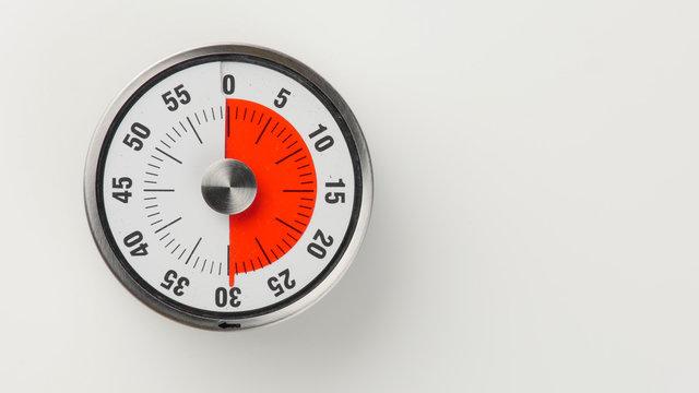 Vintage analog kitchen countdown timer, 30 minutes remaining