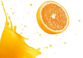 orange splashing out of fresh juice