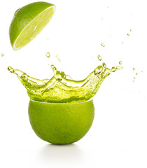 juice spraying out of a lime isolated on white