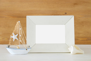 Nautical concept with sea life style objects on wooden table. For photography montage