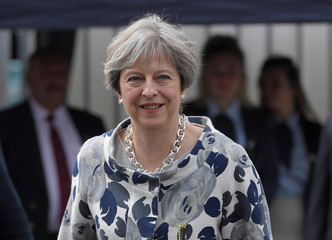Britain's Prime Minister Theresa May leaves after attending the annual Henley Royal Regatta rowing festival in Henley-on-Thames