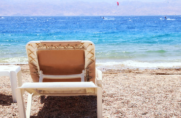 tropical sea beach and chaise lounger. Summer travel and vacation concept