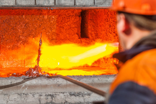 Smelter near melting furnace with molten aluminum, foundry, Russia