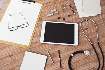 Wooden desktop with empty tablet