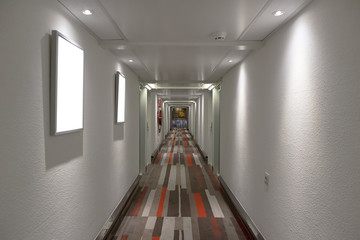 Hotel corridor with carpeted color
