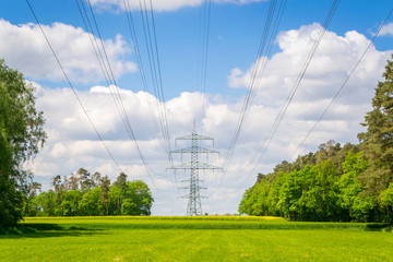 High voltage power lines at a sunny spring day