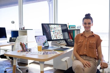 Female executive sitting at her desk