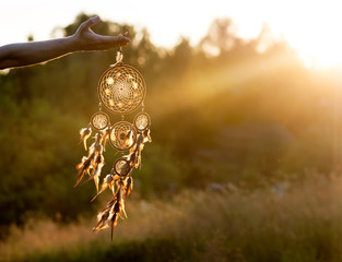 Dreamcatcher, american native amulet on sunset. Shaman