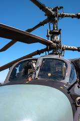 Details of the rotor and part of the body of modern military helicopters closeup.