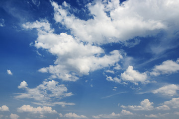 Cumulus white clouds on a blue sky background