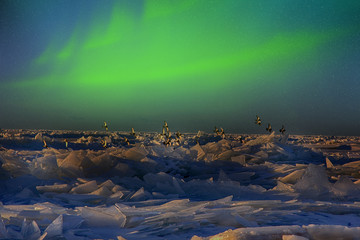 Northern lights over ice sea