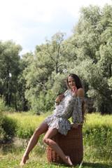 Beautiful model girl in garden, forest, enjoying nature. Style, fashion, beauty, lifestyle.