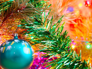 Brightly illuminated decorative ornaments and colorful toys on the Christmas tree