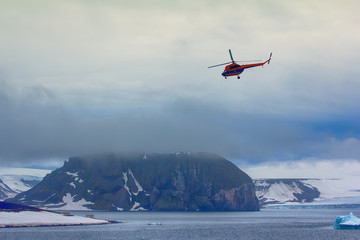 Helicopter brings scientists and extreme tourists on harsh polar Islands