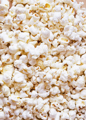 White fluffy movie theater popcorn background, top view