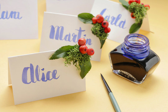 How to make wedding place name cards with handwritten letters and fresh plants