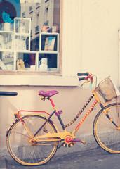 Vintage yellow bicycle in a sidewalk in Paris
