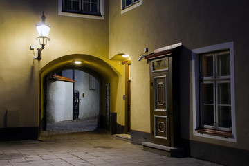 narrow street in the old Tallinn, which leads to the observation deck. the courtyard in the medieval town. White night in Estonia. The summer season.
