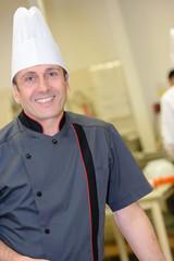 confident chef smiling