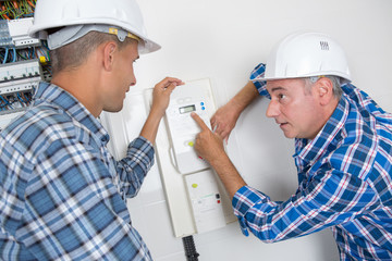 repairman engineer checking thermostat